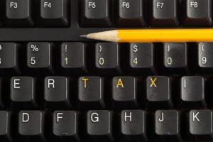 bigstock Compuer Keyboard With Tax And 55517834 300x200 - What Expatriates Need to Know About U.S. Tax Forms before Filing Taxes or Reporting Offshore Accounts